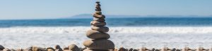 zen rocks stacked on beach